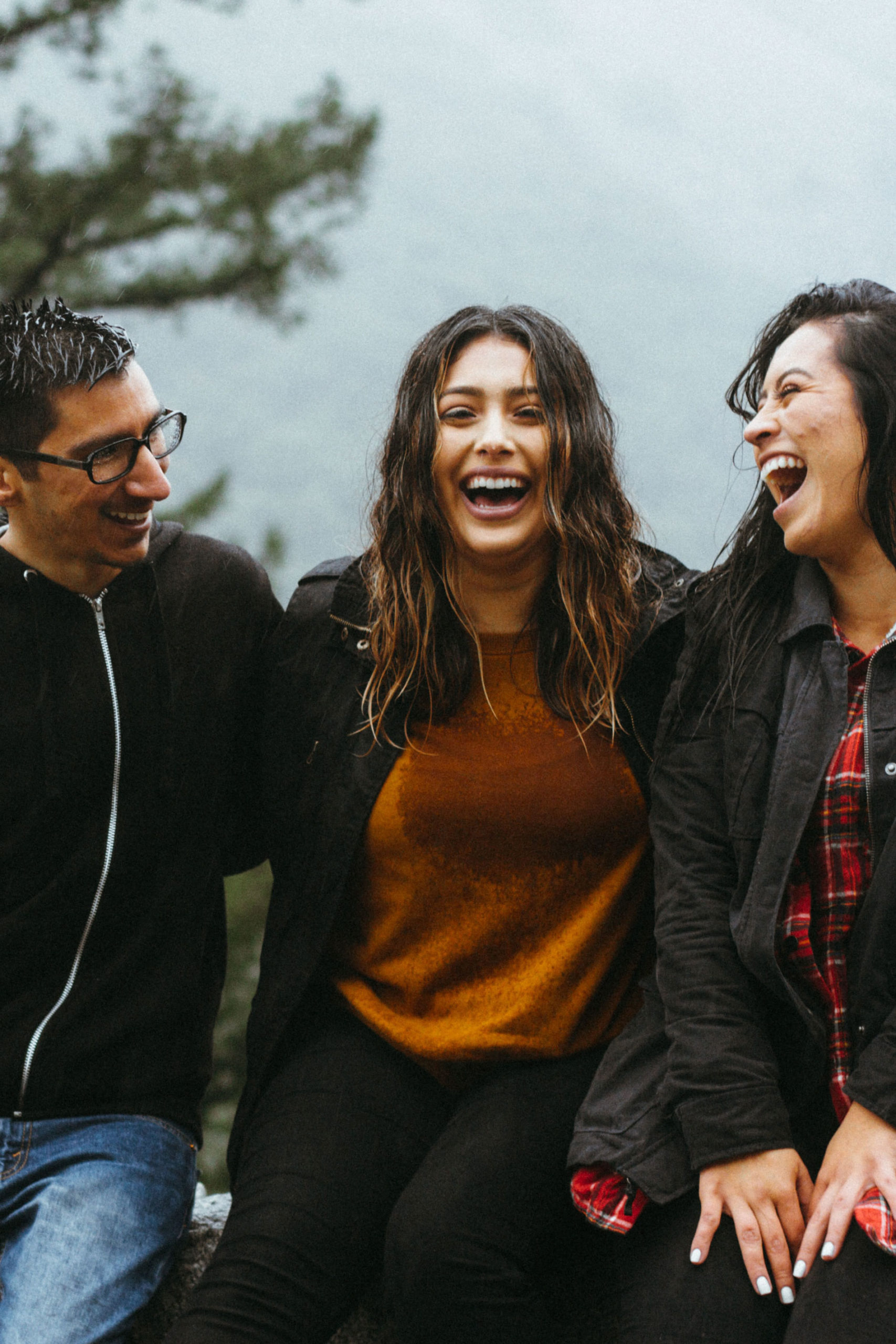 Closeup of three laughing people.
